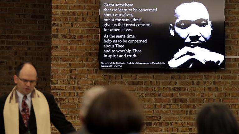 In this Jan. 17, 2020, photo Rabbi Fred Reeves, left, speaks during the Friday Shabbat Service at KAM Isaiah Israel in Chicago. (AP Photo / Nam Y. Huh)