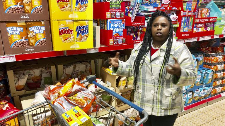 In this Sunday, Feb. 10, 2019 photo, Laquesha Russell, a 36-year-old home health care worker who makes $10.78 an hour, speaks during an interview as she shops for groceries for her four children in Springfield, Illinois. (AP Photo / John O'Connor)