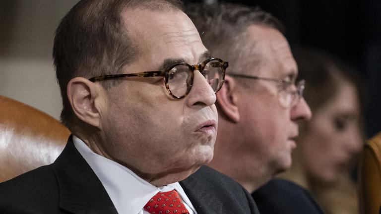 House Judiciary Committee Chairman Jerrold Nadler, D-N.Y., left, exhales after a day of work with Rep. Doug Collins, R-Ga., the ranking member, right, on the markup of articles of impeachment against President Donald Trump, Thursday, Dec. 12, 2019, on Capitol Hill in Washington. (AP Photo / J. Scott Applewhite)