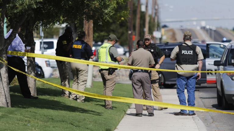 Authorities cordon off a part of the sidewalk in the 5100 block of E. 42nd Street in Odessa, Texas, Saturday, Aug. 31, 2019. Several people were dead after a gunman who hijacked a postal service vehicle in West Texas shot more than 20 people, authorities said Saturday. The gunman was killed and a few law enforcement officers were among the injured. (Mark Rogers / Odessa American via AP)