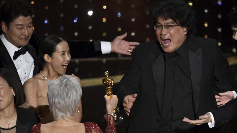 "Bong Joon Ho, right, reacts as he is presented with the award for best picture for ""Parasite"" from presenter Jane Fonda at the Oscars on Sunday, Feb. 9, 2020, at the Dolby Theatre in Los Angeles. Looking on from left are Kang-Ho Song and Kwak Sin Ae. (AP Photo / Chris Pizzello)"