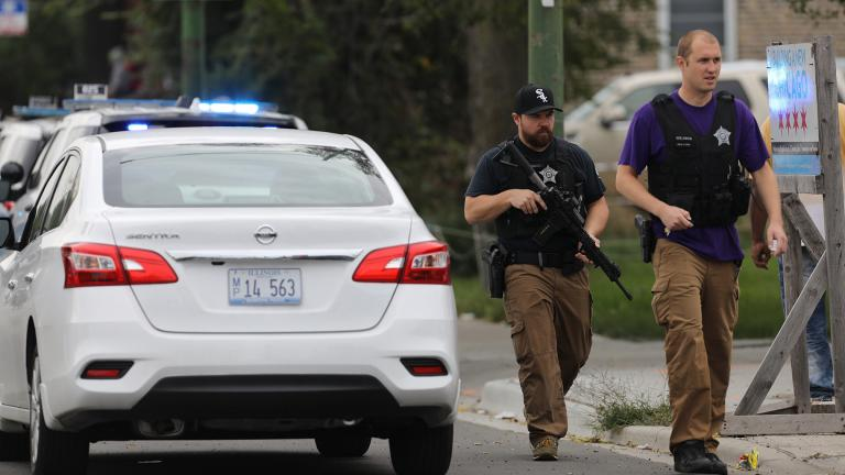 Police search for a suspect that shot a Chicago Police Department officer, near 63rd and Damen, Saturday, Sept. 21, 2019. The shooting happened around 8:40 a.m. (Abel Uribe / Chicago Tribune via AP)