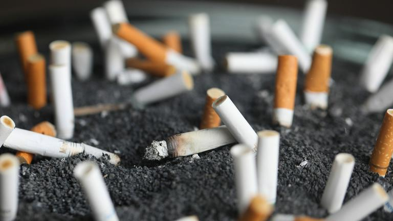 This March 28, 2019 photo shows cigarette butts in an ashtray in New York. On Wednesday, Jan. 8, 2020, researchers reported the largest-ever decline in the U.S. cancer death rate, and they are crediting advances in the treatment of lung tumors. (AP Photo / Jenny Kane, File)