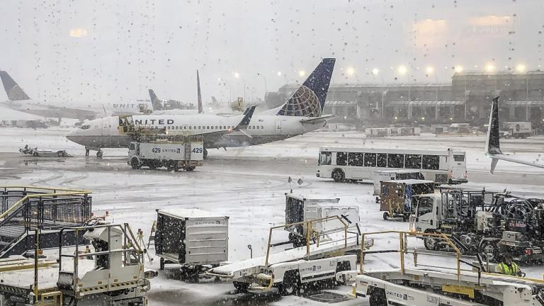 Snow falls on the United Terminal at O'Hare Airport in Chicago on Monday morning, Nov. 11, 2019. (Daryl Van Schouwen / Chicago Sun-Times via AP)