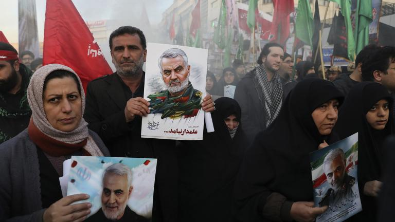 Mourners holding posters of Iranian Gen. Qassem Soleimani attend a funeral ceremony for him and his comrades, who were killed in Iraq in a U.S. drone strike on Friday, at the Enqelab-e-Eslami (Islamic Revolution) Square in Tehran, Iran, Monday, Jan. 6, 2020. (AP Photo / Ebrahim Noroozi)