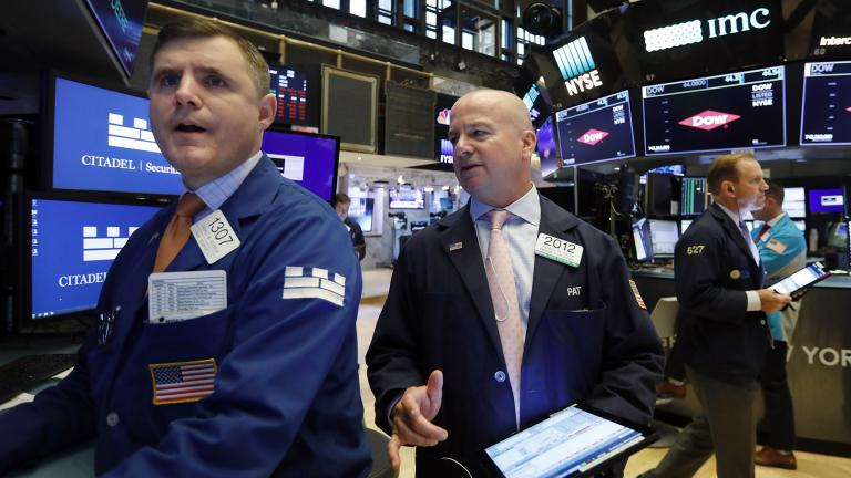 Specialist Thomas Schreck, left, and trader Patrick Casey, center, work on the floor of the New York Stock Exchange, Thursday, Aug. 15, 2019. Stocks are rising on Wall Street early Thursday on indications American consumers continue to spend and embrace online shopping. (AP Photo / Richard Drew)