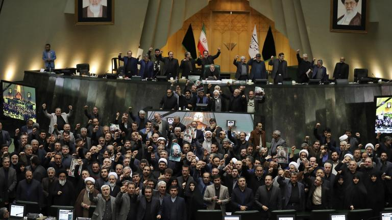 Iranian lawmakers chant slogans as some of them hold posters of Gen. Qassem Soleimani, who was killed in Iraq in a U.S. drone attack, in an open session of parliament, in Tehran, Iran, Tuesday, Jan. 7, 2020. (AP Photo / Vahid Salemi)