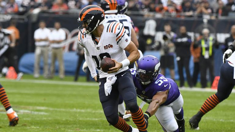 Chicago Bears quarterback Mitchell Trubisky (10) scrambles away from Minnesota Vikings outside linebacker Anthony Barr (55) during the half of an NFL football game Sunday, Sept. 29, 2019, in Chicago. (AP Photo / Matt Marton)