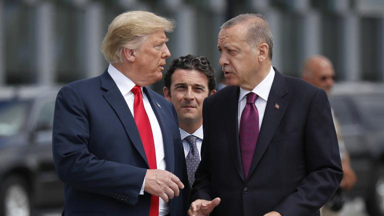 In this Wednesday, July 11, 2018, file photo, President Donald Trump, left, talks with Turkey's President Recep Tayyip Erdogan, as they arrive together for a family photo at a summit of heads of state and government at NATO headquarters in Brussels. (AP Photo / Pablo Martinez Monsivais, File)