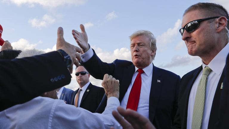 President Donald Trump reaches out to greet supporters on the tarmac upon his arrival at Palm Beach International Airport on Thursday, April 18, 2019, in West Palm Beach, Florida. (AP Photo / Pablo Martinez Monsivais)
