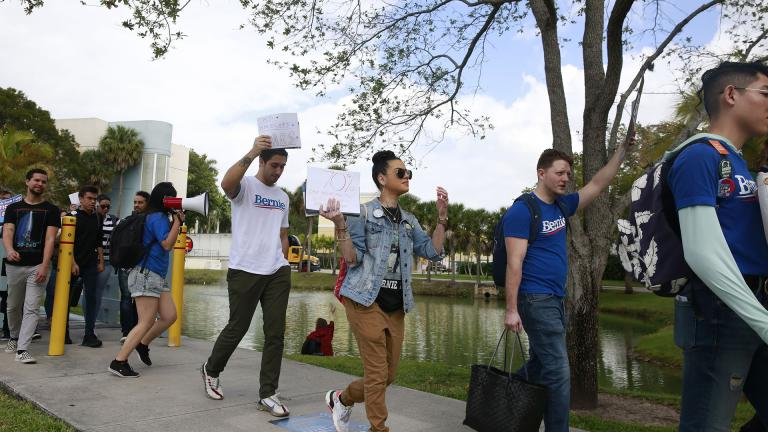 Students chant during the Bernie 2020 March to Early Vote at Florida International University to on Wednesday, March 11, 2020, in Miami. Florida and its 219 delegates could be the knockout punch for presidential hopeful Bernie Sanders after a dismal showing in the Michigan primary. (AP Photo / Brynn Anderson)