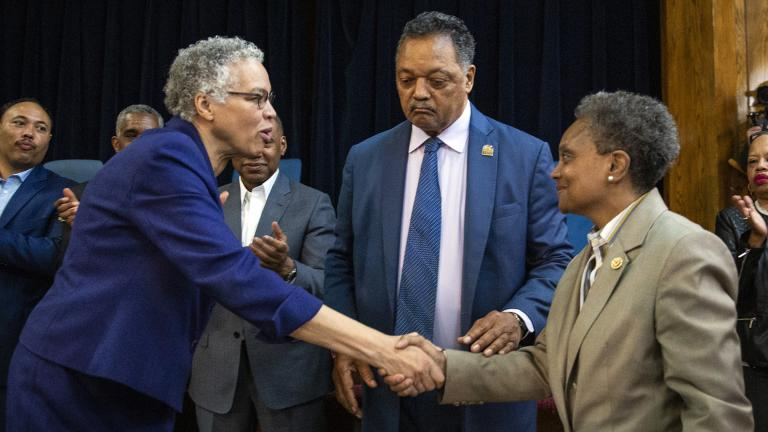 Chicago Mayor-elect Lori Lightfoot, right, shakes hands with former mayoral candidate Cook County Board President Toni Preckwinkle as Rev. Jesse Jackson look on during a press conference at the  Rainbow PUSH organization on Wednesday morning, April 3, 2019. (Ashlee Rezin / Chicago Sun-Times via AP)