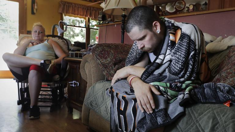 In this Monday, July 29, 2019 photo, Dylan Nelson, of Burlington, Wisconsin, and his sister, Andrea, sit for an interview. He was rushed to the hospital in June by his sister last month with severe breathing problems. Doctors believe he and about two dozen other young adults suffered serious lung injuries after vaping nicotine or THC, or both. (Rick Wood / Milwaukee Journal Sentinel via AP)