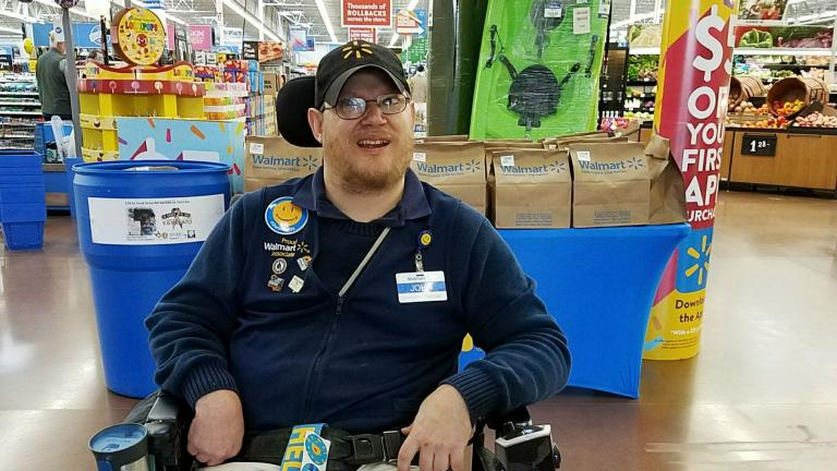 In this April 21, 2018 photo provided by Rachel Wasser, Walmart greeter John Combs works at a Walmart store in Vancouver, Washington. (Rachel Wasser via AP)