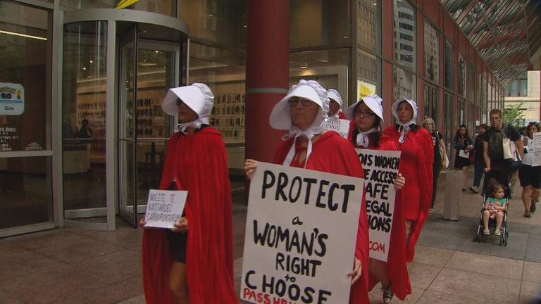 Women march past the Thompson Center in Chicago as part of an abortion rights demonstration in May 2019. (WTTW News)
