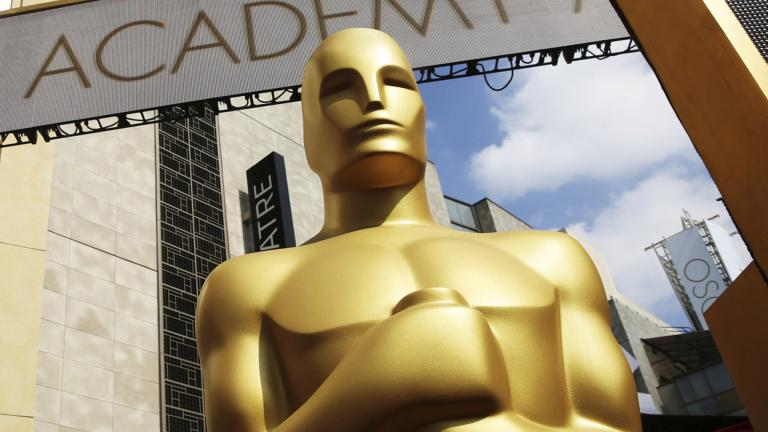 In this Feb. 21, 2015 file photo, an Oscar statue appears outside the Dolby Theatre for the 87th Academy Awards in Los Angeles. (Photo by Matt Sayles / Invision / AP, File)