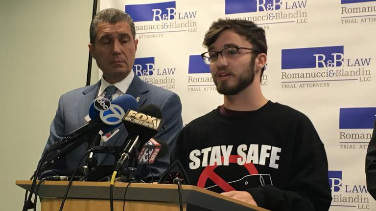Gurnee resident Adam Hergenreder, 18, right, talks about how he began using e-cigarettes at a Friday, Sept. 13 press conference alongside his attorney Antonio Romanucci. (Kristen Thometz / WTTW News)