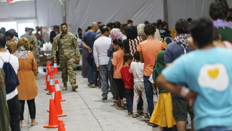 Afghan refugees line up for food in a dining hall at Fort Bliss' Doña Ana Village, in New Mexico, where they are being housed, Friday, Sept. 10, 2021. (AP Photo / David Goldman)