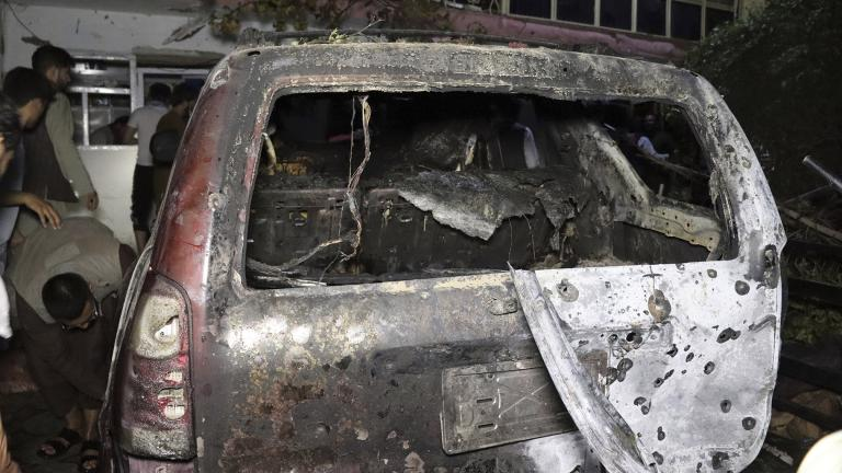 A destroyed vehicle is seen inside a house after a U.S. drone strike in Kabul, Afghanistan, Sunday, Aug. 29, 2021. (AP Photo / Khwaja Tawfiq Sediqi)