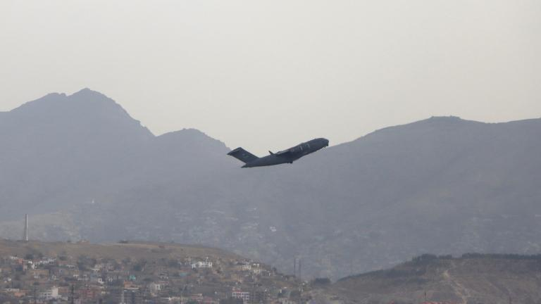 A U.S military aircraft takes off from the Hamid Karzai International Airport in Kabul, Afghanistan, Monday, Aug. 30, 2021. (AP Photo / Wali Sabawoon)