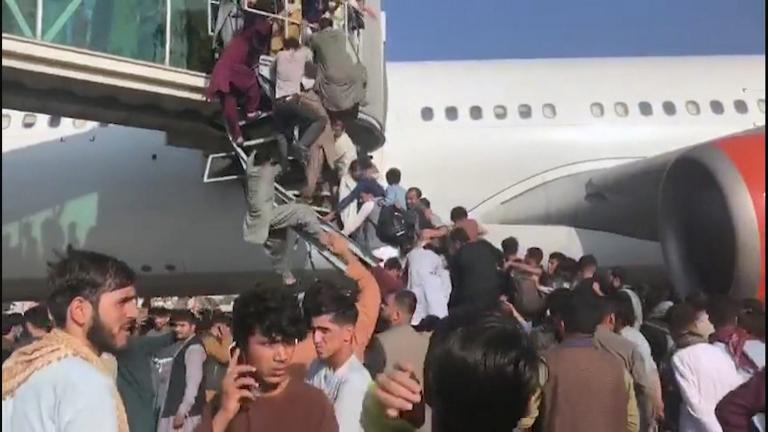 Chaos at the Kabul airport as people try to flee the country. (WTTW News via CNN)