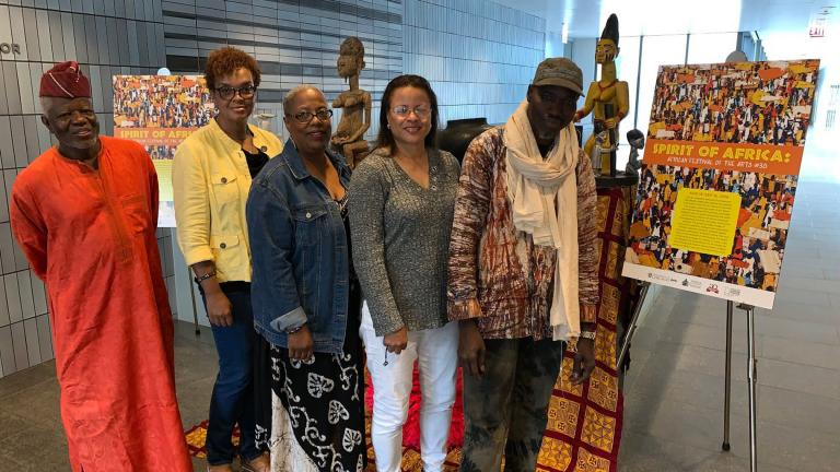 From left: Festival founder Patrick Saingbey-Woodtor, photographer Sonja Hughes, quilter Susan Trice, photographer Kaye Cooksey and collector Diarra Diaby. (Angel Idowu / WTTW News)