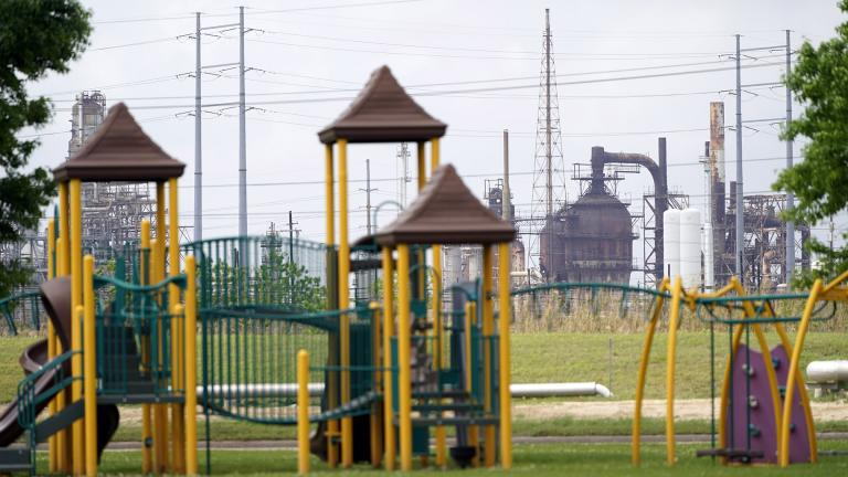 In this Monday, March 23, 2020 file photo, a playground outside the Prince Hall Village Apartments sits empty near one of the petrochemical facilities in Port Arthur, Texas. (AP Photo / David J. Phillip)