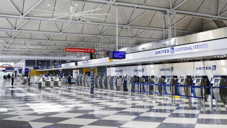 In this June 25, 2020, file photo, rows of United Airlines check-in counters at O'Hare International Airport in Chicago are unoccupied amid the coronavirus pandemic. About 40,000 workers in the airline industry are facing layoffs on Thursday, Oct. 1, unless Congress comes up with another aid package. (AP Photo/Teresa Crawford, File)