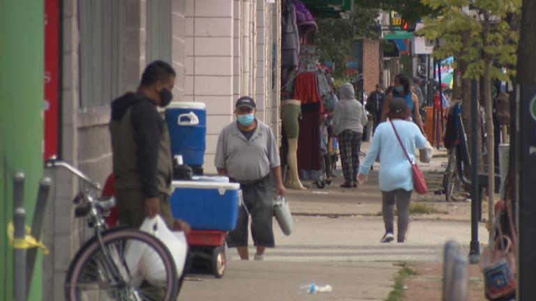 People wearing face masks walk in Chicago's Albany Park neighborhood on Friday, Sept. 18, 2020. (WTTW News)