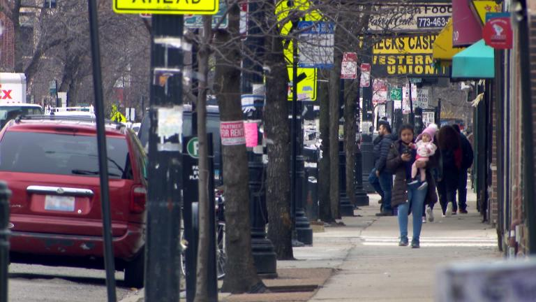 Businesses line a street in the Albany Park neighborhood. (WTTW News)