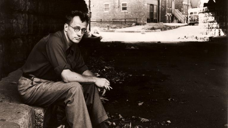 Nelson Algren sitting beneath a viaduct in Chicago. (Library of Congress)