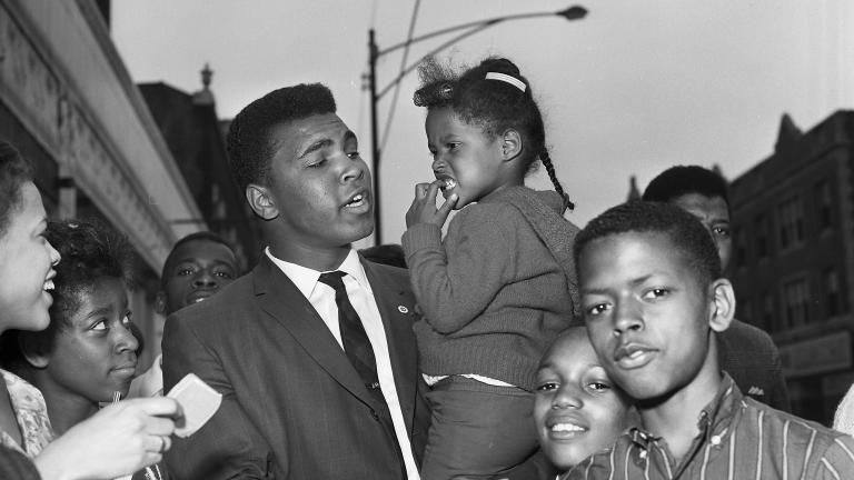 Ali loved a crowd, and often found one on 79th Street in Chicago, near the offices of Muhammad Speaks and the popular Tiger Lounge. (© Lowell K. Riley)