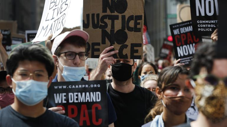 Protesters march around Chicago's City Hall, Wednesday, June 17, 2020, demanding that Mayor Lori Lightfoot enact the ordinance for an all-elected Civilian Police Accountability Council, CPAC. (AP Photo / Charles Rex Arbogast)