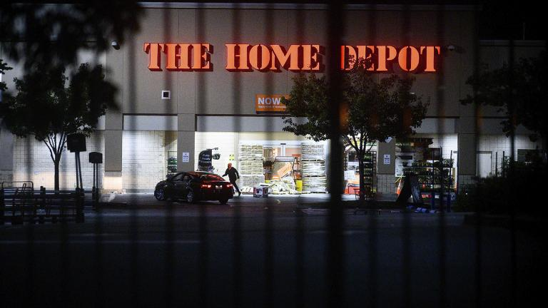 In this June 1, 2020, file photo, a man leaves a vandalized Home Depot store in Oakland, Calif.(AP Photo / Noah Berger, File)