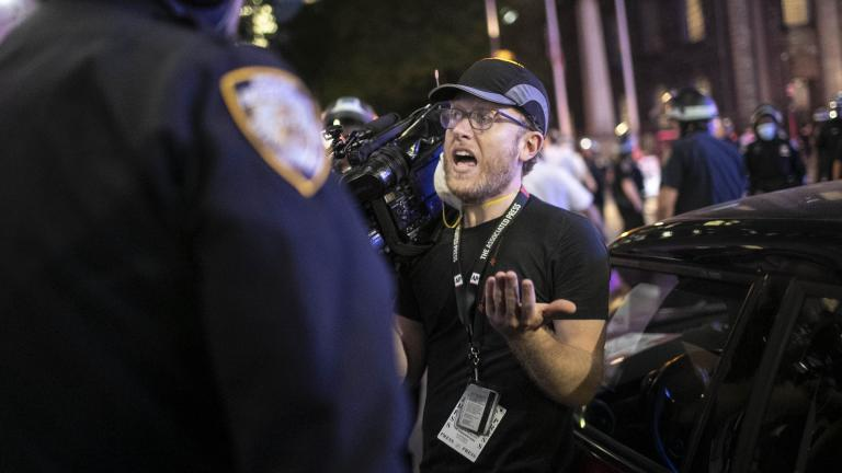 "Associated Press videojournalist Robert Bumsted reminds a police officer that the press are considered ""essential workers"" and are allowed to be on the streets despite a curfew, Tuesday, June 2, 2020, in New York. (AP Photo / Wong Maye-E)"