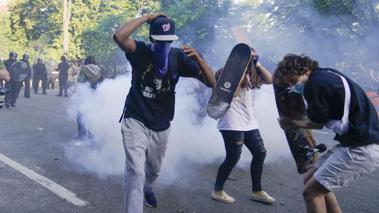 Demonstrators, who had gathered to protest the death of George Floyd, begin to run from tear gas used by police to clear the street near the White House in Washington, Monday, June 1, 2020. (AP Photo / Evan Vucci)