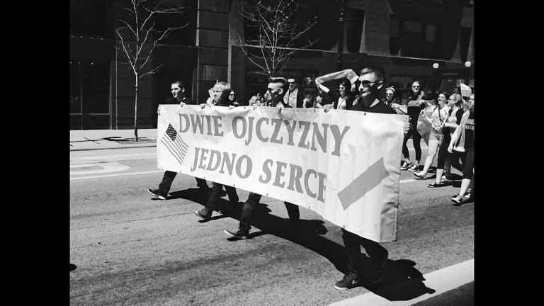 "Polish Constitution Day Parade in Chicago's Loop, May 2, 2015. The banner reads, in English, ""Two homelands, one heart,"" expressing the dual nature of Polonia. (Photograph by Dominic Pacyga)"