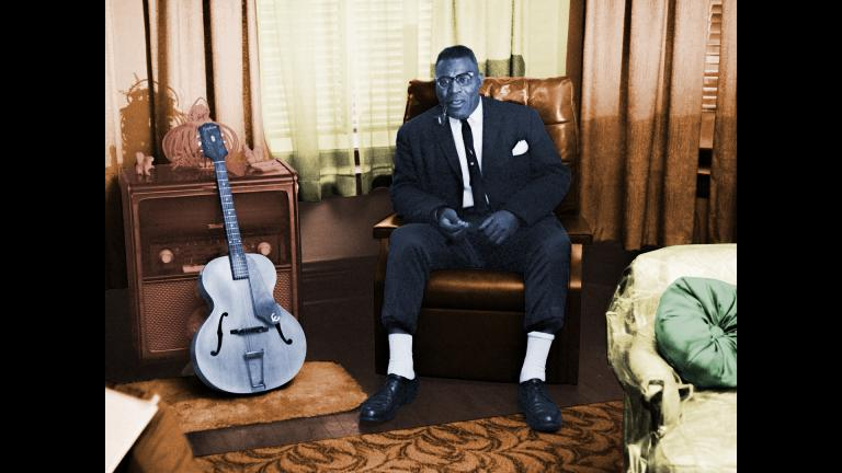 Portrait of Howlin' Wolf (Chester Burnett) at his home during an interview with Mike Bloomfield, Chicago, Illinois, 1964. Raeburn Flerlage image, colorized.