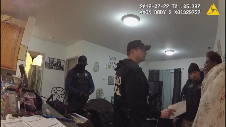 A still image from a Chicago Police Department body camera video shows a police raid at the home of Anjanette Young in February 2019. (WTTW News via Ja'Mal Green)