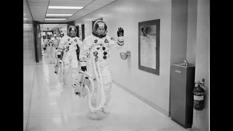 Commander Colonel Frank Borman leads the way as he, Command Module Pilot Captain James A Lovell Jr., and Lunar Module Pilot Major William A. Anders head to the launch pad for humanity's maiden voyage around the moon and its first aboard the Saturn V vehicle, developed by NASA's Marshall Space Flight Center in Huntsville, Ala. (Image credit: NASA)