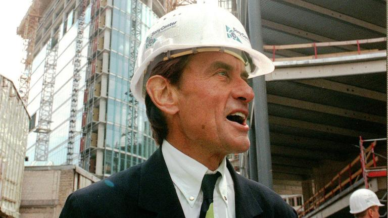 In this Wednesday, July 15, 1998 file photo, architect Helmut Jahn tours a construction site in Berlin. (AP Photos / Jockel Finck)