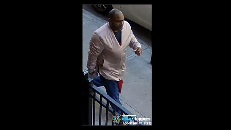 This image taken from surveillance video provided by the New York City Police Department shows a person of interest in connection with an assault of an Asian American woman, Monday, March 29, 2021, in New York. (Courtesy of New York Police Department via AP)