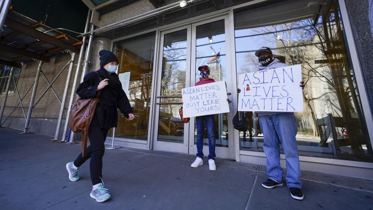 Community activists Calvin, right, and Cameron Hunt show support for the Asian community outside the building where an Asian American woman was assaulted, Tuesday, March 30, 2021, in New York. (AP Photo / Mary Altaffer)