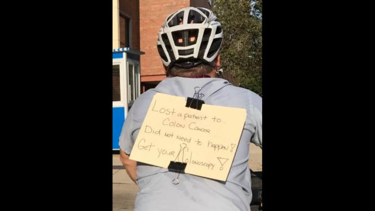 Advocate Illinois Masonic Medical Center gastroenterologist Dr. Andrew Albert rides home wearing a sign urging people to be screened for colon cancer after one of his patients died and another who had never had a colonoscopy was found to have a tumor. (Courtesy of Dr. Andrew Albert)