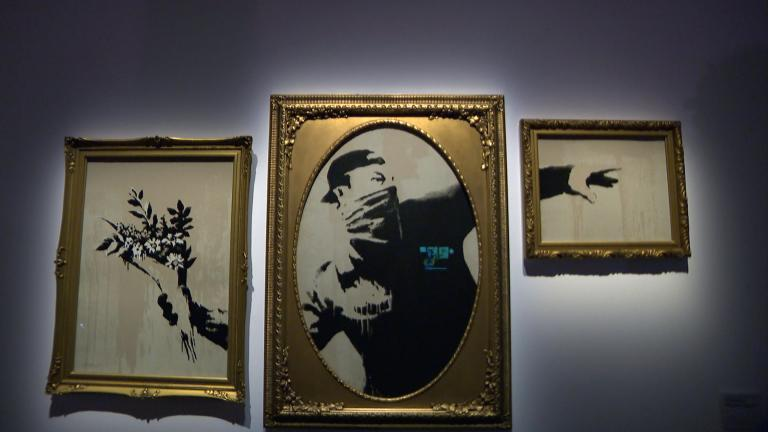 """""""Flower Thrower"""" is one of many recognizable work featured in """"The Art of Banksy."""" (WTTW News)"""