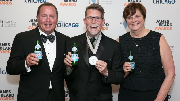 Rick Bayless, center, poses with his wife and business partner, Deann, and Dave Hardie, director of San Pellegrino. (Credit: Huge Galdones)