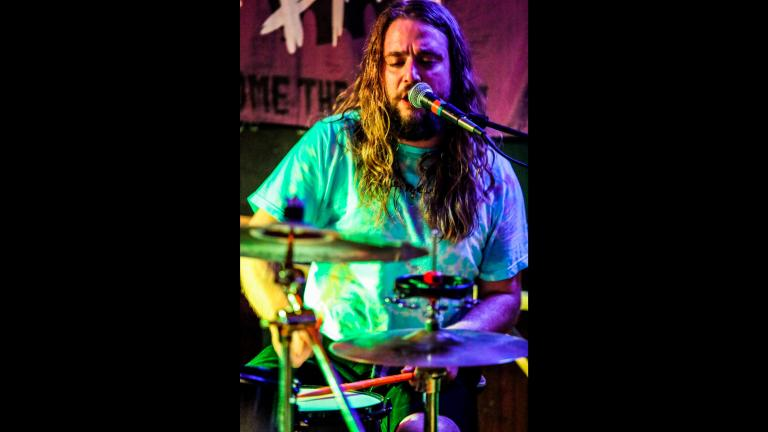 """In a photo provided by Russ Boxer, Kevin Clark plays drums as Jess Bess & The Intentions performs at a bar in Highwood, Ill., May 22, 2021. Clark, who played drummer Freddy """"Spazzy McGee"""" Jones in the 2003 movie """"School of Rock"""" with Jack Black, was killed when he was struck by a car while riding his bicycle along a Chicago street early Wednesday, May 26. (Russ Boxer via AP)In a photo provided by Russ Boxer, Kevin Clark plays drums as Jess Bess & The Intentions performs at a bar in Highwood, Ill., May 22, 2"""