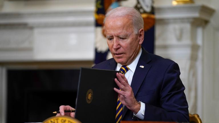 President Joe Biden closes the folder after signing an executive order relating to U.S. supply chains, in the State Dining Room of the White House, Wednesday, Feb. 24, 2021, in Washington. (AP Photo / Evan Vucci)
