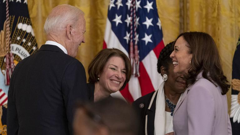 President Joe Biden, Sen. Amy Klobuchar, D-Minn., center, and Vice President Kamala Harris, right, share a laugh after the president signed H.R. 1652, the VOCA Fix to Sustain the Crime Victims Fund Act of 2021, in the East Room of the White House in Washington, Thursday, July 22, 2021. (AP Photo / Andrew Harnik)