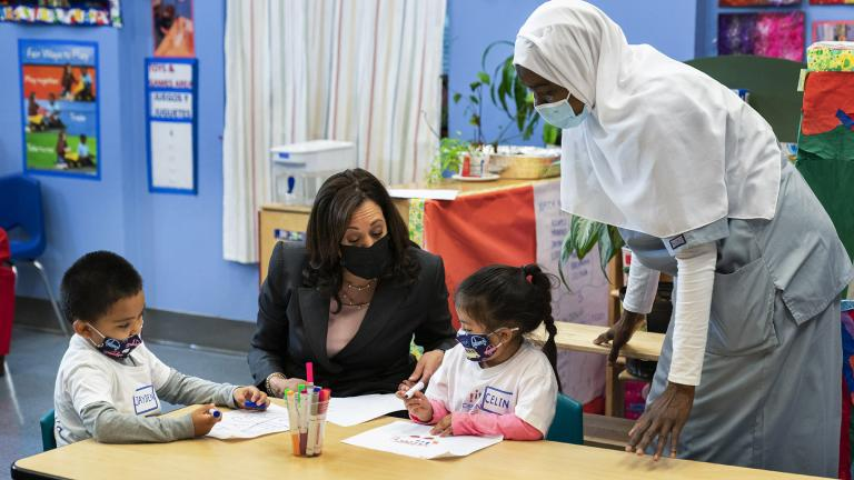In this June 11, 2021, file photo, Vice President Kamala Harris talks with bilingual early childhood education school CentroNia students Jayden Bello, left, and Celina Barrera during a visit to the school in northwest Washington. Teacher Billo Diawara, right, watches. (AP Photo / Manuel Balce Ceneta, File)